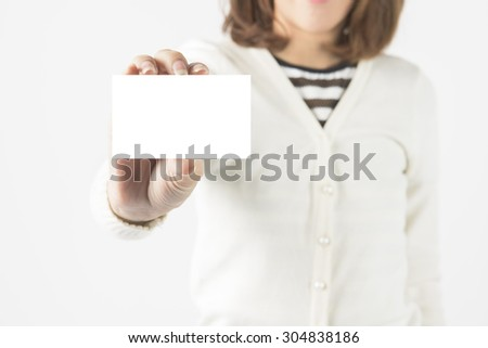 Asian Business Woman With Pen Drawing Light Bulb. Concept for New Ideas - stock photo