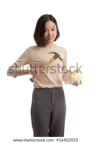 Asian business woman with pig coin bank and hammer  isolated on white background