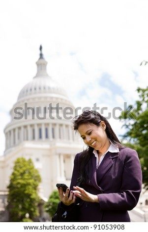 Asian business woman with smartphone on Capitol Hill in Washington DC
