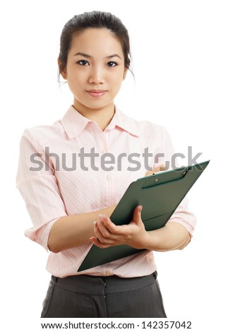 Asian business woman with writing pad - stock photo