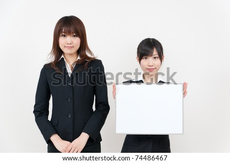 asian business women holding a blank whiteboard