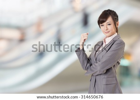 Asian business young woman look at you, closeup portrait. - stock photo