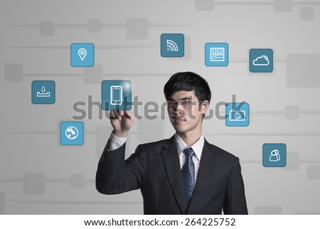 Asian businessman analyzing business growth