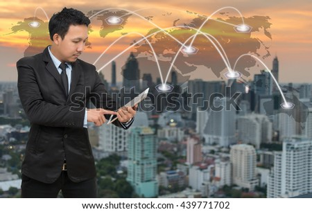 Asian businessman calling mobile phone with network connection on cityscape with world map background, Business connection concept, Elements of this image furnished by NASA