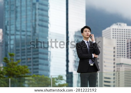 Asian businessman chat on cellphone