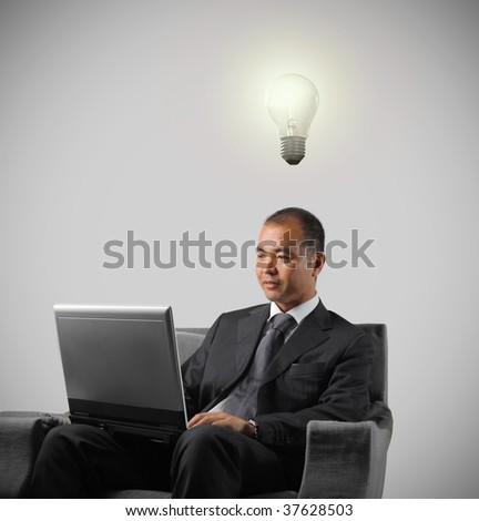 asian businessman having an idea - stock photo