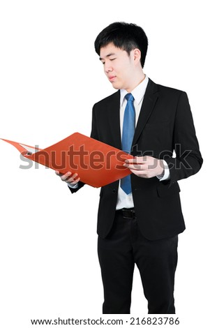 Asian businessman hold the red files with checking (clipping path) - stock photo