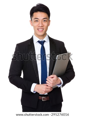 Asian businessman hold with laptop computer - stock photo