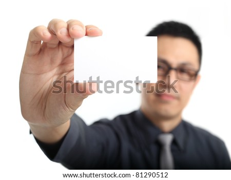Asian businessman holding a business card
