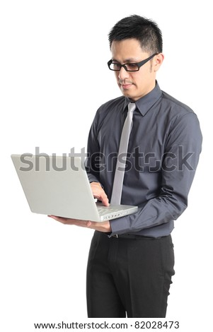 Asian businessman holding a laptop. Isolated on white background. - stock photo