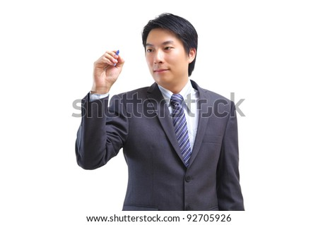 Asian businessman holds pen and writing, drawing in the air isolated on white - stock photo