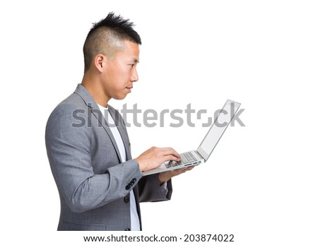 Asian businessman look at laptop computer