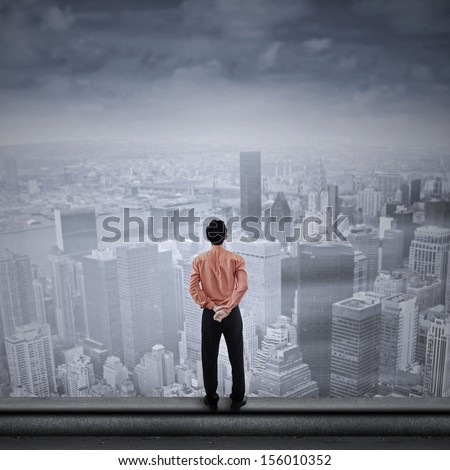 Asian businessman looking to the future - stock photo