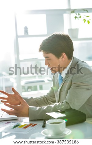 Asian businessman on his desk in office