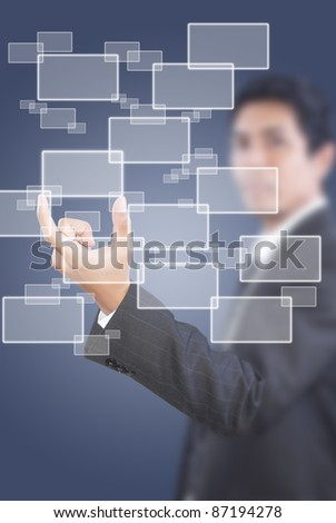 Asian businessman pushing button on the whiteboard.