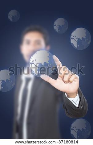 Asian businessman pushing globe on the whiteboard. - stock photo