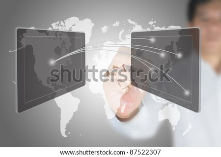 Asian businessman pushing social network on tablet screen. - stock photo