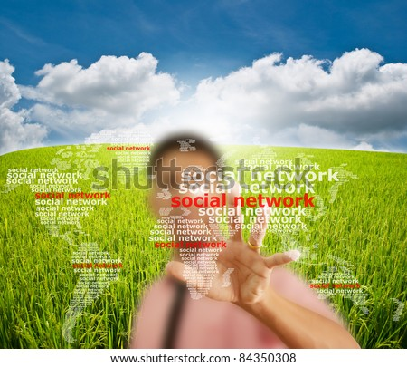 Asian businessman pushing social network on the blue sky field. - stock photo