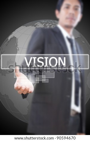 Asian businessman pushing vision word on a touch screen interface. - stock photo