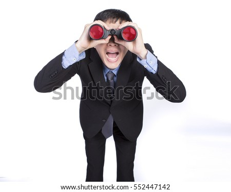 Asian businessman seeing through binoculars and showing exciting expression with mouth wide opened