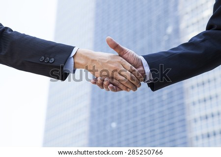 Asian businessman shaking hand - stock photo