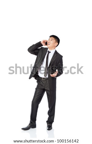 Asian businessman talking on mobile cell phone, happy smile looking up, using cellphone,full length portrait of handsome young business man phone call, wear elegant suit isolated over white background - stock photo