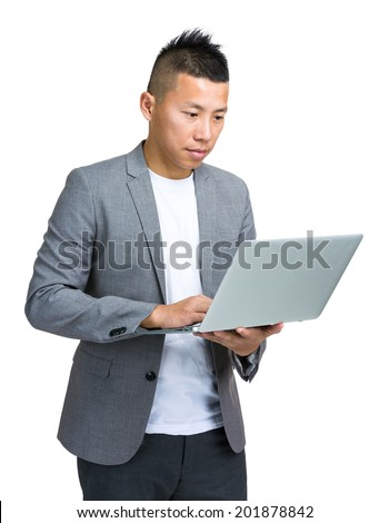 Asian businessman use laptop computer