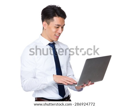 Asian businessman use of notebook computer