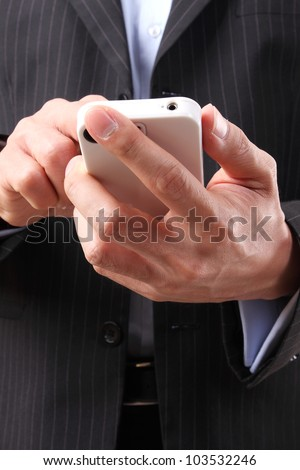 Asian businessman using a mobile phone on the white background