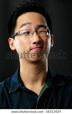 Asian businessman winking - stock photo