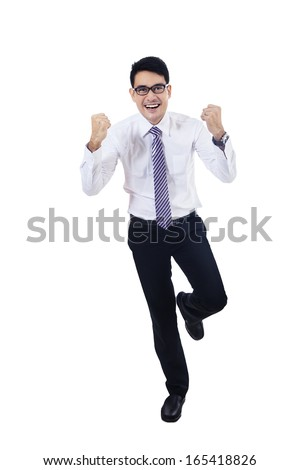 Asian businessman with clenched fist success isolated - stock photo