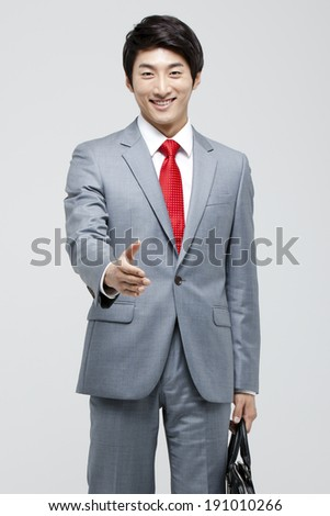 Asian businessman with hand out  - stock photo