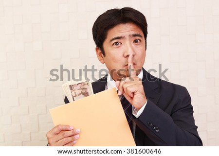 Asian businessman with money - stock photo