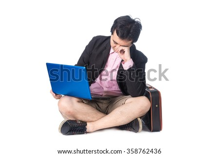 Asian businessman working on computer laptop, crying, desperate and worried in work stress and business problems, isolated - stock photo