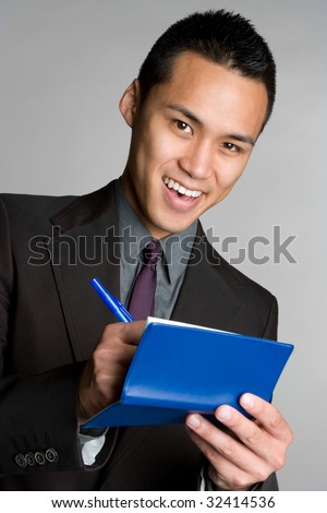 Asian Businessman Writing Check - stock photo