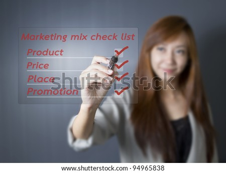 Asian businesswoman checking for marketing mix.