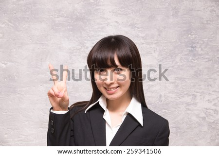 asian businesswoman counting two - stock photo