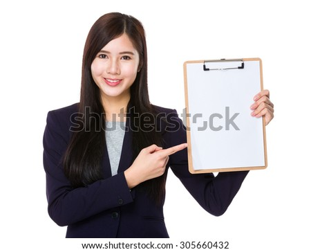 Asian businesswoman finger point to clipboard - stock photo