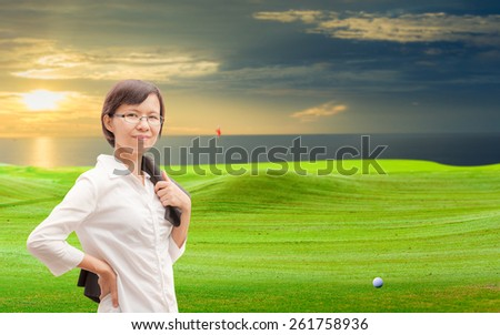 Asian businesswoman on Golf Course. - stock photo