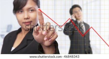 Asian businesswoman pointing growth graph with businessman on background,