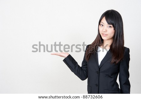 asian businesswoman showing - stock photo