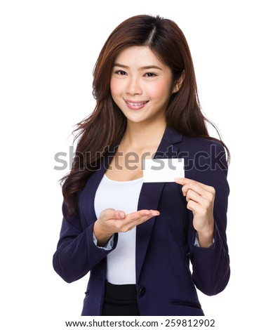 Asian businesswoman showing name card - stock photo