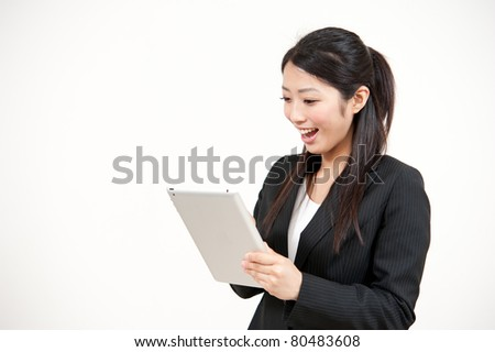 asian businesswoman using computer isolated on white background - stock photo