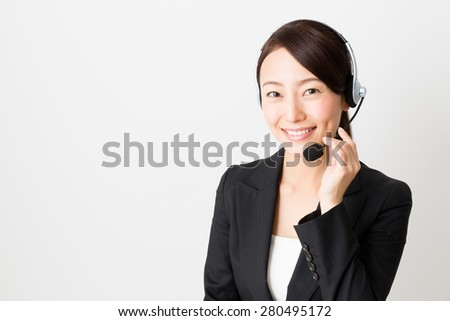 asian businesswoman using headset - stock photo