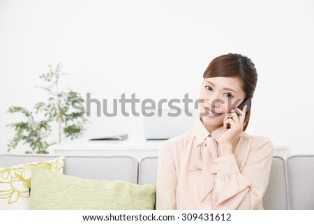 Asian businesswoman using smart phone - stock photo