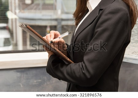 Asian businesswoman with binder