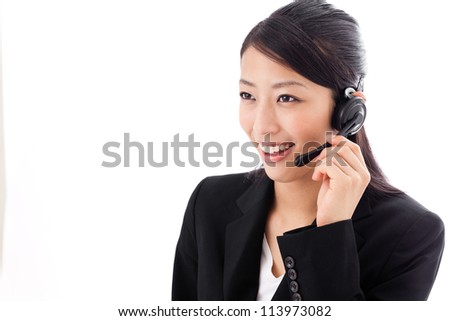 asian businesswoman with headset on white background - stock photo