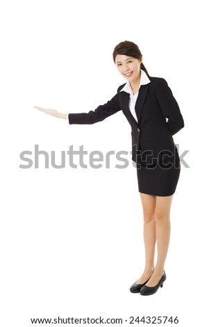 asian Businesswoman with her arm out in a welcoming gesture - stock photo