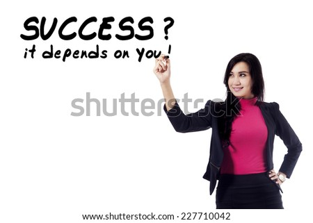 Asian businesswoman writes suggestion word on whiteboard, isolated on white