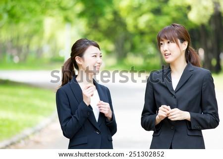asian businesswomen in the park - stock photo